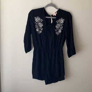 Black romper with white flowers